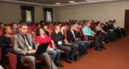Зрители в зале на конференции
